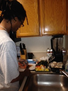 Chef Shelli whips up fish and veggies for dinner